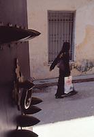 Tanzania Zanzibar Woman walking in an alley in Stone Town