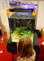Una bambina osserva un prototipo per il controllo e l'automazione di un acquario alla Maker Faire, mostra sull'innovazione tecnologica, a Roma, 4 ottobre 2014.<br /> A child observes a prototype for aquarium control and automation displayed at the Maker Faire exhibition on technological innovation in Rome, 4 October 2014.<br /> UPDATE IMAGES PRESS/Riccardo De Luca