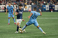 FOXBOROUGH, MA - SEPTEMBER 29: Ismael Tajouri-Shradi #29 of New York City FC tackles Carles Gil #22 of New England Revolution during a game between New York City FC and New England Revolution at Gillettes Stadium on September 29, 2019 in Foxborough, Massachusetts.