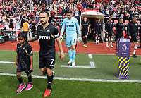 Leon Britton of Swansea City walks to the pitch with child mascot prior to the Premier League match between Southampton and Swansea City at the St Mary's Stadium, Southampton, England, UK. Saturday 12 August 2017