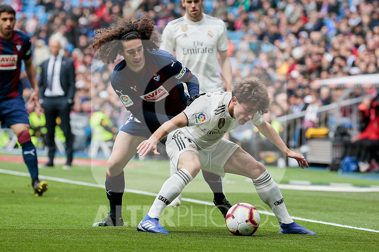Real Madrid's Alvaro Odriozola and SD Eibar's Marc Cucurella during La Liga match between Real Madrid and SD Eibar at Santiago Bernabeu Stadium in Madrid, Spain.April 06, 2019. (ALTERPHOTOS/A. Perez Meca)
