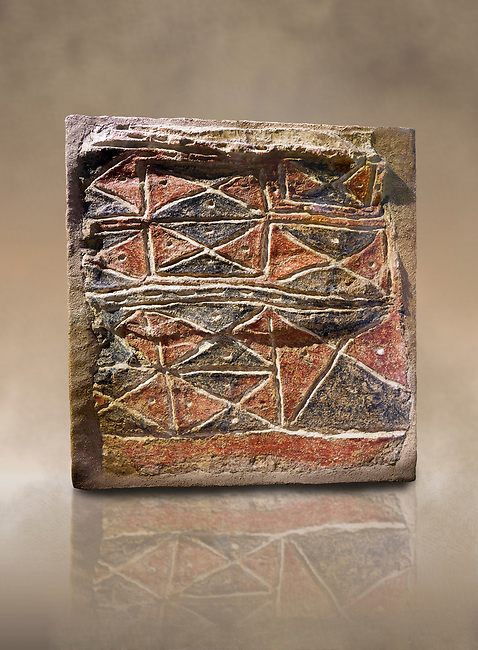 Wall fresco of geometric red and black triangles which appears to be a rug pattern copy. 6000 BC. . Catalhoyuk Collections. Museum of Anatolian Civilisations, Ankara