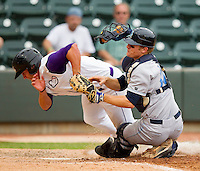 Brady Shoemaker #21 of the Winston-Salem Dash collides with Wilmington Blue Rocks catcher Kevin David #12 as he is thrown out trying to score on a fly ball at BB&T Ballpark on June 10, 2012 in Winston-Salem, North Carolina.  The Dash defeated the Blue Rocks 2-0.  (Brian Westerholt/Four Seam Images)