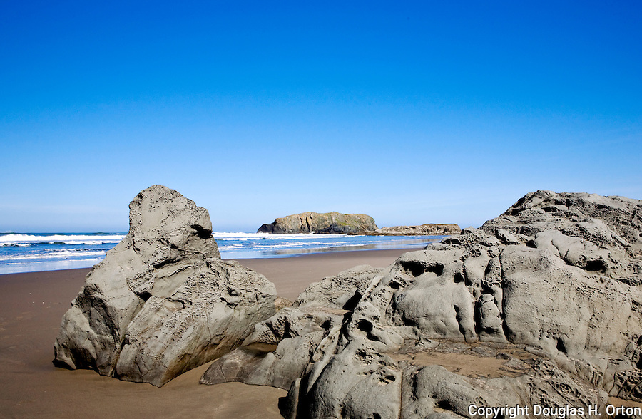 Devil's Kitchen in one of many Bandon State Park access points to Bandon Beach, Oregon.  This access is favored by local folks, and reaches miles of sandy beaches and sea stacks.