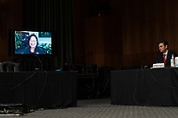 "United States Senator Mazie Hirono (Democrat of Hawaii), seen through a tv screen attending remotely, asks a question at a US Senate Judiciary Committee Hearing ""to examine COVID-19 fraud, focusing on law enforcement's response to those exploiting the pandemic"" on Capitol Hill in Washington, DC on June 9, 2020. <br /> Credit: Erin Schaff / Pool via CNP/AdMedia"