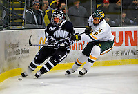 1 February 2008: University of New Hampshire Wildcats' forward Mike Sislo, a Freshman from Superior, Wis., controls the puck against University of Vermont Catamounts' defenceman Kyle Medvec, a Freshman from Burnsville, MN, at Gutterson Fieldhouse in Burlington, Vermont. The seventh-ranked Wildcats defeated the Catamounts 5-1in front of a sellout crowd of 4,003...Mandatory Photo Credit: Ed Wolfstein Photo