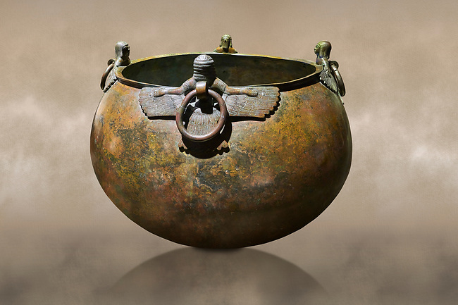 Phrygian bronze couldron with decorated winged figure handles . From Gordion. Phrygian Collection, 8th century BC - Museum of Anatolian Civilisations Ankara. Turkey. Against an art background