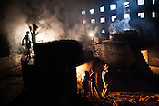 Workers from the lowest caste are seen working at a leather waste processing unit in Bojerhat, South 24 Parganas in West Bengal, India. The workers toil through the day in hazardous working conditions, melting the waste leather and turning it into a fertilizer for tea plants.