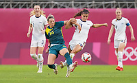 KASHIMA, JAPAN - JULY 27: Alanna Kennedy #14 of Australia battles with Alex Morgan #13 of the United States before a game between Australia and USWNT at Ibaraki Kashima Stadium on July 27, 2021 in Kashima, Japan.