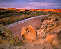 Sunrise glow along the Little Missouri River; Theodore Roosevelt National Park, ND