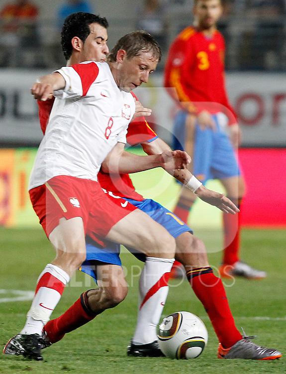 Spain's Sergio Busquets and Poland's Murawski during Friendly match.June, 8, 2010. (ALTERPHOTOS/Acero)
