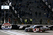 #51: Kyle Busch, Kyle Busch Motorsports, Toyota Tundra Cessna drives under the checkered flag to win