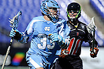 Face-Off Classic:  Midfielder Jeff Froccaro # 10 of the Princeton Tigers defend Midfielder Ryan Creighton #33 of the North Carolina Tar Heels during the Princeton v North Carolina mens lacrosse game at M&T Bank Stadium on March 10, 2012 in Baltimore, Maryland. (Ryan Lasek/Eclipse Sportswire)