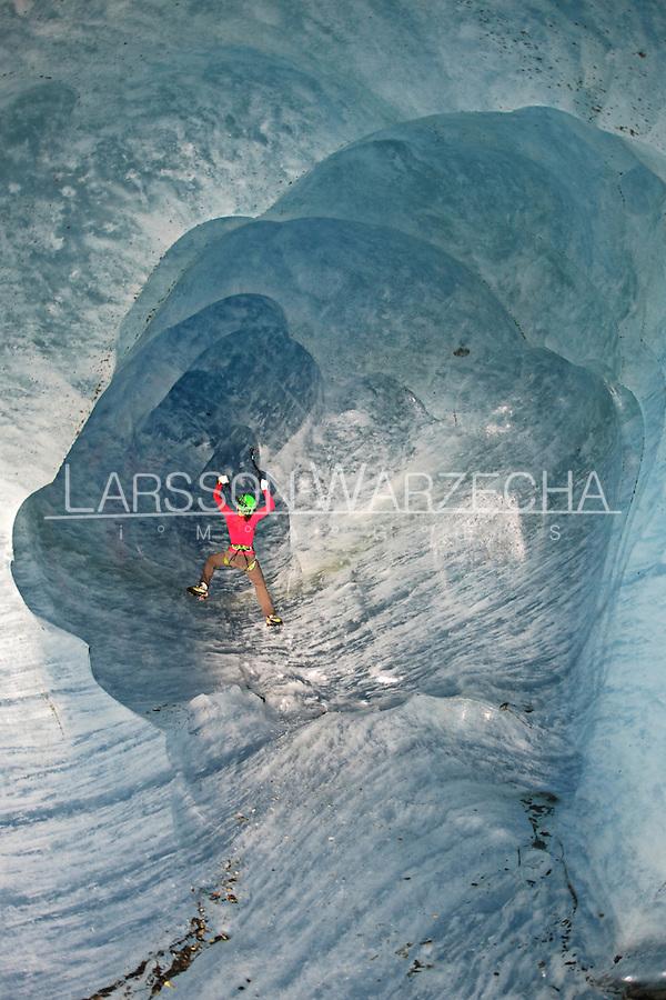 Stephanie Maureau climbing an ice cave under the Mer de Glace glacier, Chamonix, France