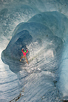 Stephanie Maureau climbing an ice cave under the Mer de Glace glacier, Chamonix, France