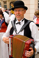 Man in traditional attire playing accordian, Prague, Czech Republic