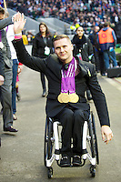 David Weir, winner of four gold medals in the London 2012 Paralympics, is applauded by the crowd during half time of the Cook Cup between England and Australia, part of the QBE International series, at Twickenham on Saturday 17th November 2012 (Photo by Rob Munro)