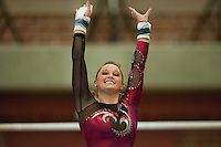STANFORD, CA-JANUARY 22, 2012 - Jenny Peter celebrates a successful bars routine en route to Stanford's win over the visiting University of Washington Gym Dawgs at Burnham Pavilion on the Stanford Campus.