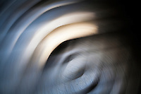 Light, shadows and curves - an abstract created with slow shutter and motion.