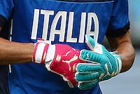 The odd coloured pink and blue Puma goalkeeping gloves of Italy goalkeeper Gianluigi Buffon