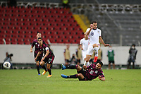 GUADALAJARA, MEXICO - MARCH 24: Hassani Dotson #18 of the United States jumps over the tackle of Jose Esquivel #16 of Mexico during a game between Mexico and USMNT U-23 at Estadio Jalisco on March 24, 2021 in Guadalajara, Mexico.
