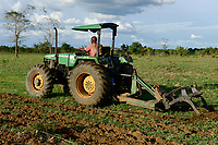 ZAMBIA, Mazabuka, farm of medium scale farmer Stephen Chinyama , he practise conservation farming, ripping furrows with John deere Tractor to sow cotton seeds, ripping protects the soil instead of ploughing, clouds during raining season