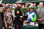 23 October. Senada and Edgar Prado win the 20th running of the Rood and Riddle Dowager (Listed) $125,000 at Keeneland Racecourse for owner Lael Stables and trainer Barclay Tagg.  Military Day special guest, Sergeant Dakota Meyer who was awarded the Medal of Honor on Sept 15th, 2011 presents the winners trophy.