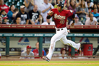 Houston Astros outfielder Jimmy Paredes #38 sprints home during the Major League baseball game against the Philadelphia Phillies on September 16th, 2012 at Minute Maid Park in Houston, Texas. The Astros defeated the Phillies 7-6. (Andrew Woolley/Four Seam Images).