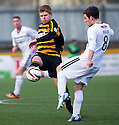 Raith Rovers' Kevin Moon clears from Alloa's Ryan McCord.