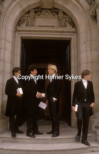 Eton 6th form boys in traditional school tail coats. School Uniform.