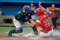 Connecticut Tigers catcher Bennett Pickar #14 attempts to tag Jacob Wilson #32 sliding in during a game against the Batavia Muckdogs at Dwyer Stadium on July 4, 2012 in Batavia, New York.  Batavia defeated Connecticut 3-2.  (Mike Janes/Four Seam Images)