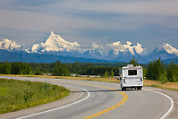 Motor home travels the Richardson Highway, against the backdrop of the Alaska Range, just south of Fairbanks, Interior, Alaska.