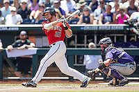 Texas Tech Red Raiders third baseman Hunter Hargrove (25) follows through on his swing against the TCU Horned Frogs in Game 3 of the NCAA College World Series on June 19, 2016 at TD Ameritrade Park in Omaha, Nebraska. TCU defeated Texas Tech 5-3. (Andrew Woolley/Four Seam Images)