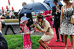 The Governor General's wife, Sharon Johnston, is presented with flowers upon her arrival at Queen's Plate  at Woodbine Raceway in Toronto, Canada on July 07, 2013.