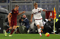 Calcio, Serie A: Roma vs Milan. Roma, stadio Olimpico, 9 gennaio 2016.<br /> AC Milan's Keisuke Honda, right, is chased by Roma's Lucas Digne during the Italian Serie A football match between Roma and Milan at Rome's Olympic stadium, 9 January 2016.<br /> UPDATE IMAGES PRESS/Riccardo De Luca