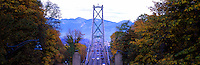 Lions Gate Bridge crossing from Stanley Park, Vancouver, to North Vancouver, BC, British Columbia, Canada - North Shore Mountains (Coast Mountain Range) beyond - Panoramic View