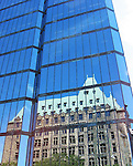 Reflection of vintage building in mirrored high rise in downtown Toronto
