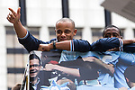 © Joel Goodman - 07973 332324  . 23/05/2011 . Manchester, UK . VINCENT KOMPANY on the bus. Tens of thousands of fans line the streets of Manchester as Manchester City Football Club hold an open-topped bus parade through the city. The team are celebrating winning the FA Cup, their first trophy in 35 years, and for qualifying for next season's Champions League . Photo credit: Joel Goodman