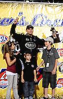 Jun. 19, 2011; Bristol, TN, USA: NHRA top fuel dragster driver Larry Dixon and his children celebrates after the Thunder Valley Nationals at Bristol Dragway. Mandatory Credit: Mark J. Rebilas-