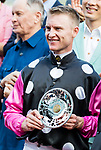 Jockey Zac Purton, who rode #1 Beauty Generation, (L)  poses for photo with trophy after winning the celebration cup (Handicap) during Hong Kong Racing at Sha Tin Racecourse on October 01, 2018 in Hong Kong, Hong Kong. Photo by Yu Chun Christopher Wong / Power Sport Images