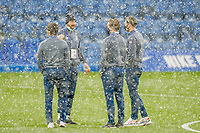 Danny Hylton (9) of Luton Town (2nd left) surveys the pitch with Luton Town players as snow falls ahead of  the FA Cup 4th round behind closed doors match between Chelsea and Luton Town at Stamford Bridge, London, England on 24 January 2021. Photo by David Horn.