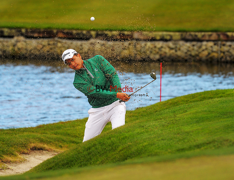 Ha Jin-bo (Korea) chips onto the 4th green on day one of the 2017 Asia-Pacific Amateur Championship day one at Royal Wellington Golf Club in Wellington, New Zealand on Thursday, 26 October 2017. Photo: Dave Lintott / lintottphoto.co.nz