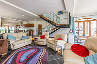 BNPS.co.uk (01202 558833)<br /> Pic: PurpleBricks/BNPS<br /> <br /> Pictured: An open lounge area.<br /> <br /> A luxury ten-bedroom eco-home has gone on sale for offers in excess of £850,000 - the same price as a one-bedroom flat in Chelsea.<br /> <br /> The new owner will buy the chance to become an eco-laird, as the property can be run entirely off-grid and includes four lochs and 38 acres of land which could potentially be re-wilded.<br /> <br /> Leadburn Manor at West Linton is just 12 miles south of Edinburgh in Scotland, but looks out over open countryside.
