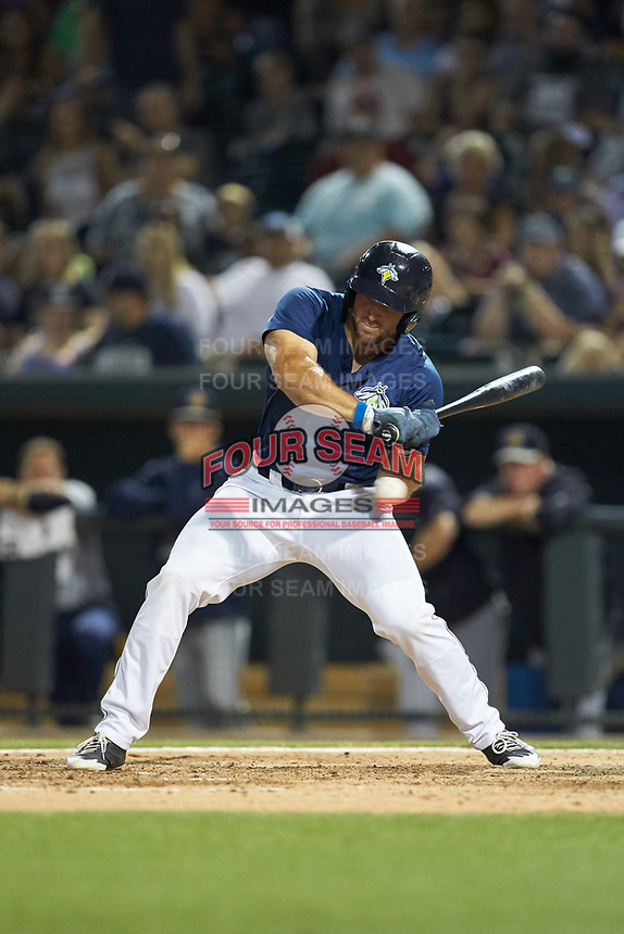 Tim Tebow (15) of the Columbia Fireflies watches a strike go by during the game against the Charleston RiverDogs at Spirit Communications Park on June 9, 2017 in Columbia, South Carolina.  The Fireflies defeated the RiverDogs 3-1.  (Brian Westerholt/Four Seam Images)