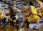 SIOUX FALLS, SD - MARCH 7: Franck Kamgain #11 of the UMKC Kangaroos looks for help around the defense from the North Dakota State Bison during the Summit League Basketball Tournament at the Sanford Pentagon in Sioux Falls, SD. (Photo by Dave Eggen/Inertia)