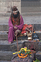 Pashupatinath, Nepal.  Sadhu (Holy Man) at Nepal's Holiest Hindu Temple, on Steps Leading down to the Bagmati River.