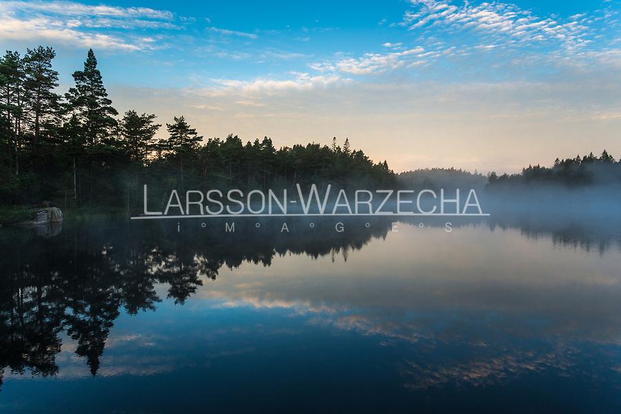 Sunrise above a lake in West Sweden, Sweden - Västsverige, Sverige
