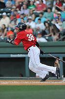 Catcher Jhon Nunez (38) of the Greenville Drive bats in a game against the Columbia Fireflies on Saturday, April 23, 2016, at Fluor Field at the West End in Greenville, South Carolina. Columbia won, 7-3. (Tom Priddy/Four Seam Images)