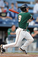 Greensboro Grasshoppers second baseman Austin Barnes #8 swings at a pitch during game one of the South Atlantic League, Southern Division playoffs between the Greensboro Grasshoppers and the Asheville Tourists at McCormick Field on September 10, 2012 in Asheville, North Carolina . The Grasshoppers defeated the Tourists 6-3. (Tony Farlow/Four Seam Images).