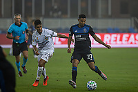 SAN JOSE, CA - SEPTEMBER 13: Efrain Alvarez #26 of the L.A Galaxy and Marcos Lopez #27 of the San Jose Earthquakes battle for the ball during a game between Los Angeles Galaxy and San Jose Earthquakes at Earthquakes Stadium on September 13, 2020 in San Jose, California.